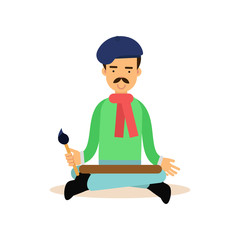Artist meditating with brush in his hand in lotus pose