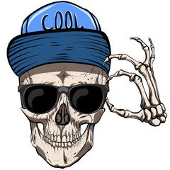 Glasses and cap on the skull. Fashionable guy.