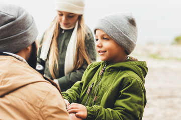 father spending time with kids outdoors