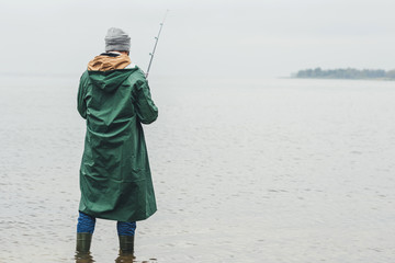 man fishing on rainy day