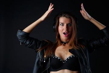 Studio image of young model in headphones, underwear
