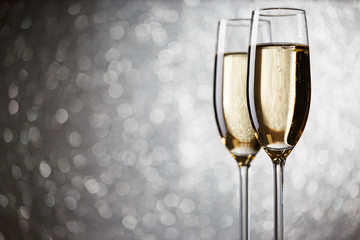 Festive picture of two wine glasses with sparkling champagne