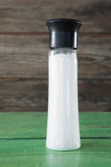 Close-up of white sea salt in shaker bottle