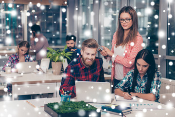 Business manager checking financial task of her colleagues. Snowflakes,winter background