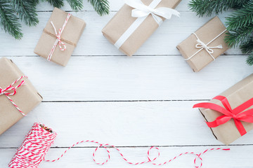 Christmas background - Christmas present gifts boxes with decorative elements on white wooden background. Creative Flat layout and top view composition with border and copy space design.
