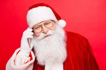 Funny santa in headwear, costume, white gloves ready, prepared to celebrate holly jolly x mas noel. Sale promotion, winter december, chatting on telephone, discuss wishes and dreams of kids
