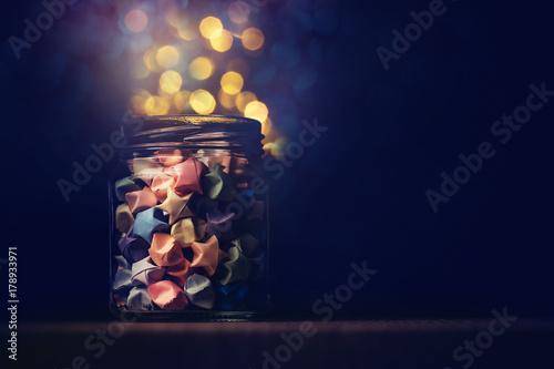Star Origami In Glass Jar With Festival Light In Dark Night Symbol