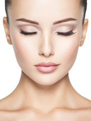 Beautiful and calm face of young woman with  health skin