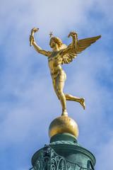 """Gilded statue Genie de la Liberte at July Column on Bastille Square. Place de la Bastille - square in Paris, where Bastille prison stood until """"Storming of Bastille"""" during French Revolution. France."""