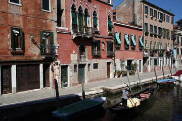 Gondola with gondolier and people in venice italy