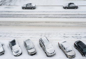 cars on parking in snow top view
