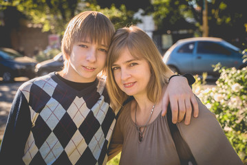portrait Mother and son teenager outdoor