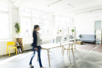 Businesswoman walking in a loft