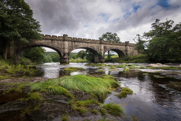 Old beautiful bridge over river Wharfe Bolton Abbey England