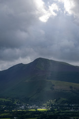 The heaven breaks open and clouds move aside lighting up the beautiful countryside of Keswick England