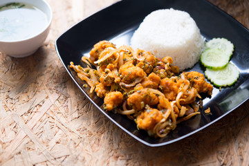 Rice with Spicy fried chicken salad - Thai cuisine