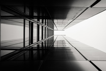 Urban Geometry, looking up. Modern architecture, glass and steel building. Abstract architectural design. Inspirational, artistic image. Industrial design. Minimal architecture view. Building exterior
