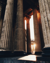 Ancient columns and beautiful sunshine through them. Old bilduing. Archtiectural monument. Historic attraction. Famous bilduing, image outdoors