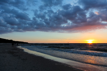 The sunset is seen from the beach