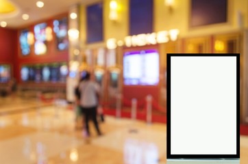 advertising billboard or blank showcase light box for your text message or media content with people buy cinema tickets from automatic ticket machine at movie theater, commercial and marketing concept