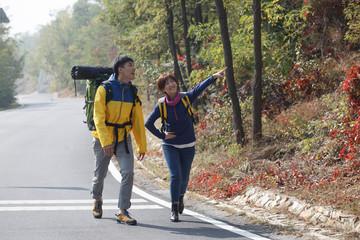 Young men and women climbing