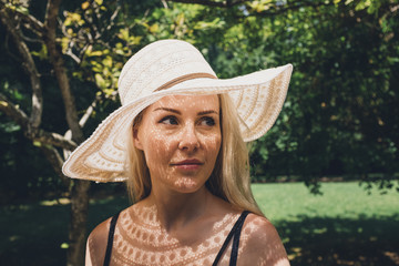 Close-up of thoughtful woman wearing hat at park