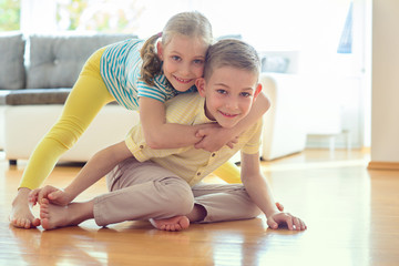 Cute little brother and sister having fun
