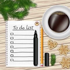 Notebook with to do list, fir tree branches, cookie, a pencil, a marker, and coffee cup on a table with wooden texture.