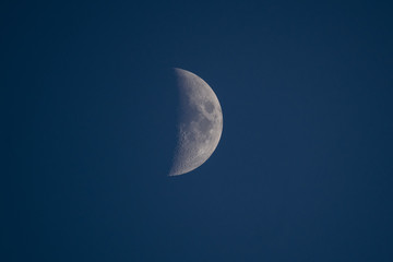 Moon background. Half of the moon on the blue background. Astronomy