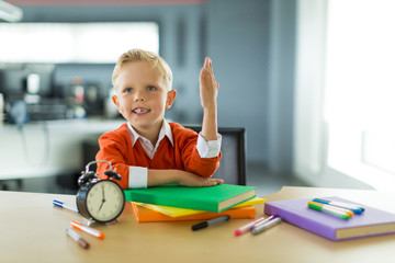 Young boy sit at the desk in the office