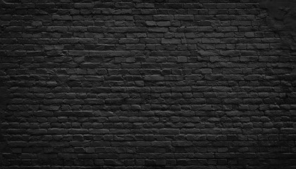 Old black brick wall background.