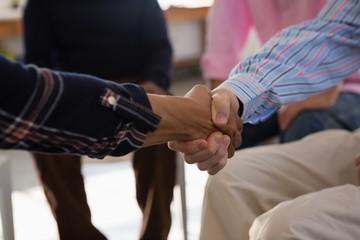 Close up of friends doing handshake