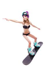 girl in bikini riding snowboard