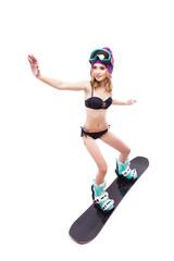 young pretty woman in black bikini ride snowboard