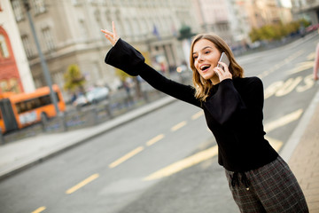 Young woman waiting for taxi or bus