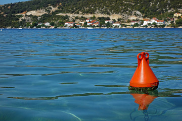 one red buoy and a sea
