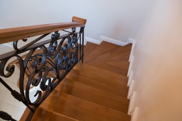 Interior wooden stairs with metal railing