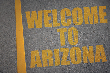 asphalt road with text welcome to arizona near yellow line