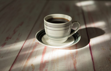 A cup of instant coffee place on old wood background