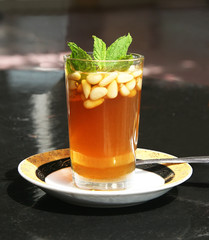 Tea with mint and pine nuts