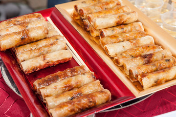 Demonstration Cooking, fried spring rolls on plastic coaster,