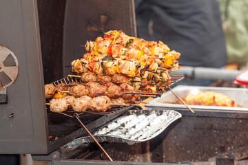 Making Shish Kebab. Barbecue shish kebab, grilled meat and vegetable.