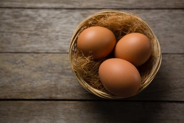 Three eggs on wicker bowl