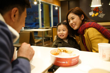 Happy family dining in a restaurant