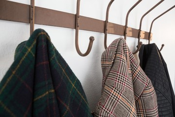 Close-up of warm clothes hanging on hook