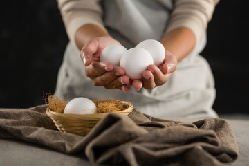 Woman holding white eggs