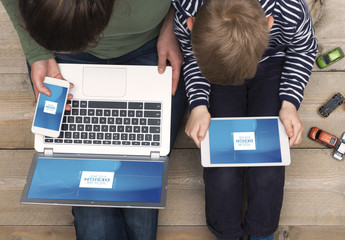 Top View Mockup of Mother and Son Sitting on Floor with Devices 2