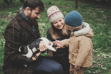 Parents give the child a dog fox terrier Outdoor