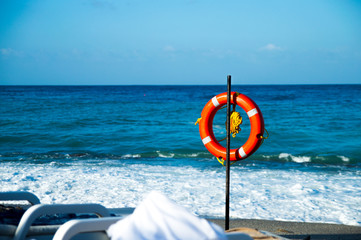 Red lifebuoy on the beach