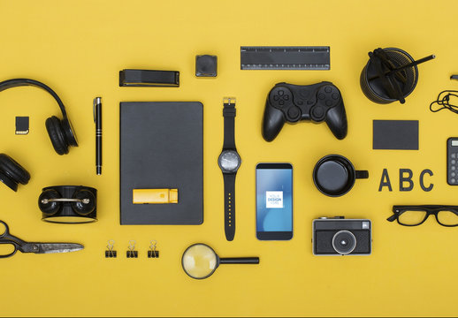 Top View Mockup of Smartphone with Desk Accessories on Yellow Background